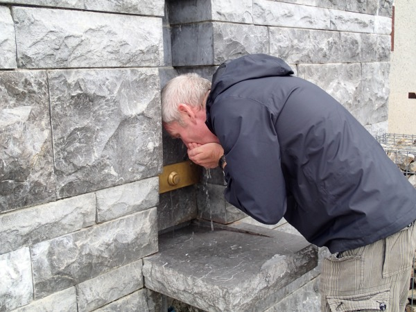 Nigel drinking the holy water at Lourdes 2019.
